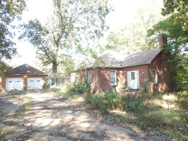 Tract 1: +/-2.9 Ac. with +/-219 Ft. Road Frontage- Restorable 3 BR Home